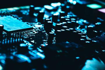 computer motherboard in blue dark background close-up