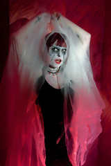 female zombie in misty mystical garb