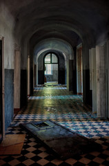 Dark spooky corridor in an old abandoned hospital buiding with s