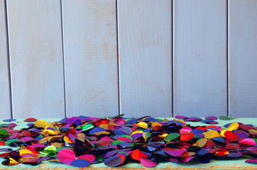 Party colorful confetti on wooden table