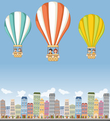 Cartoon kids inside a hot air balloon flying over colorful city.
