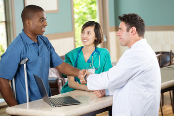 Doctor shaking hands with a patient.
