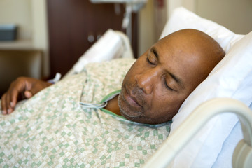 African American man in a hospital bed.