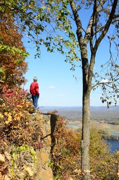 Man Standing on a Cliff Above the Mississippi River