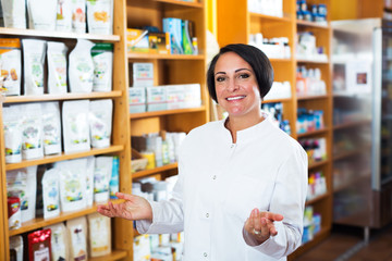 Female pharmacist in store