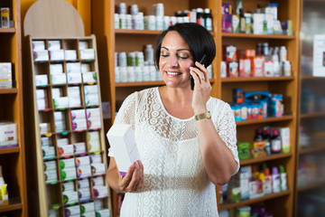 Woman with phone in store