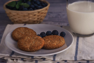 Oatmeal cookies close up with cup of milk
