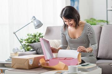 Woman unboxing a parcel