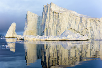 Glaciers are on the arctic ocean in Greenland, there is beautiful iceberg shadow on the sea