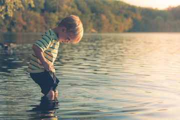 Boy Wading into Lake