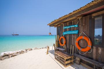 wooden hut on the beach at Mai-Ton Island