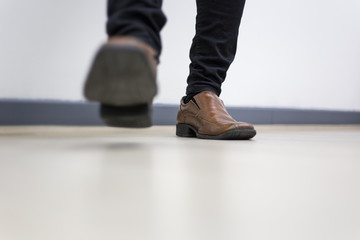 Half leg of man Walking in the office