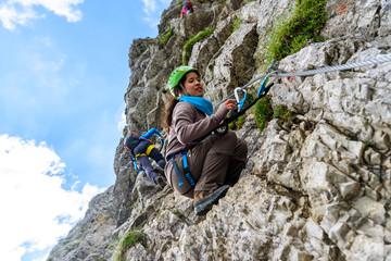 Foto op Aluminium Alpinisme Hiker climbing in the mountain of Alps, Europe