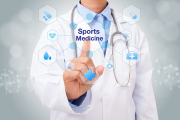 Doctor hand touching sport medicine sign on virtual screen. medical concept
