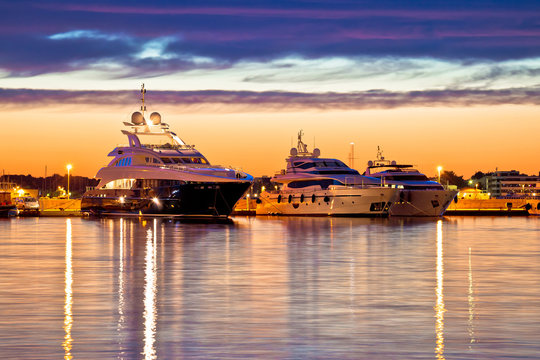 Luxury yachts harbor at golden hour view