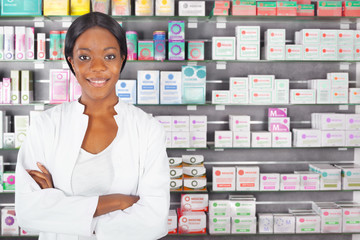Young black pharmacist in pharmacy
