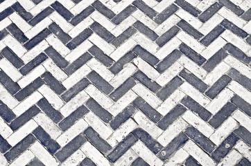 Black and white ceramic pavement