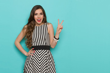 Happy Elegant Woman Showing Peace Hand Sign