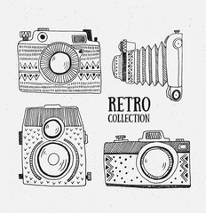 Retro photo cameras set. Vector illustration. Vintage cameras with ornaments. Hipster vector set.