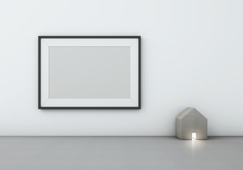 Blank black picture frame on white wall with wood house-shaped lamp - 3D rendering
