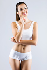 Young woman with beautiful body posing on white background.