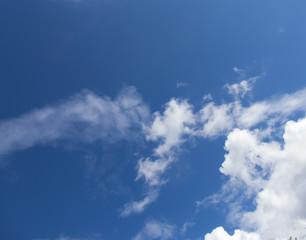 White clouds in a dark blue sky in Europe