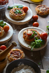Rustic table with mini pizzas of bacon