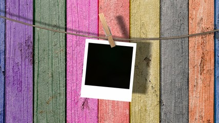 one blank instant photo hanging on the clothesline