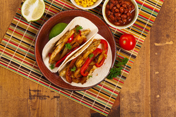 Fajita Chicken Tacos with Grilled Onions and Bell Peppers. Selective focus.