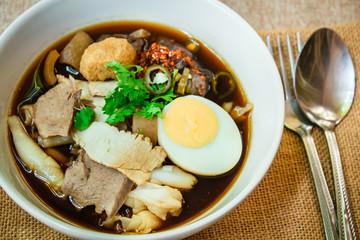 Paste of rice flour or Crunchy pork soup.