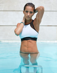 Beautiful young female in swimming pool