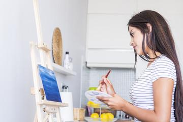 Teenage girl painting