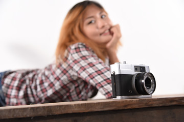 Portrait of a woman making photo on camera isolated on a white b