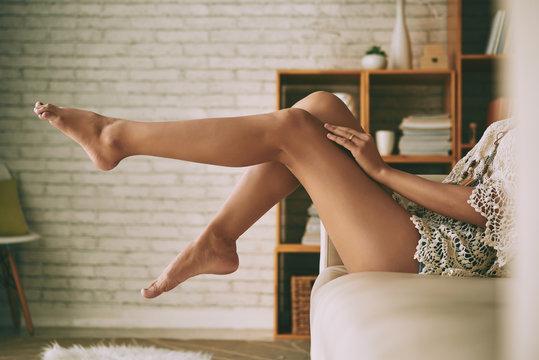 Beautiful sensual bare legs of young woman