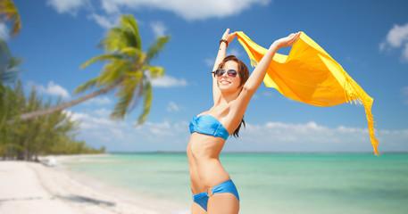 woman in bikini and sunglasses over tropical beach