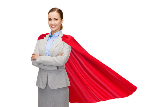 young smiling businesswoman in red superhero cape