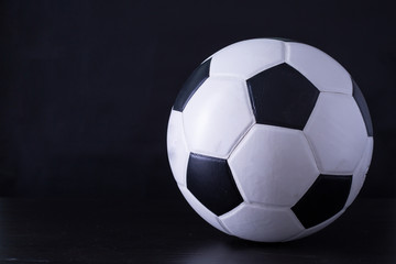Soccer ball close up with black background