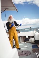 Fisherman holding fish