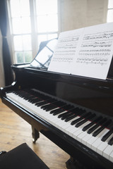 Sheet music on a Grand Piano in a rehearsal studio.