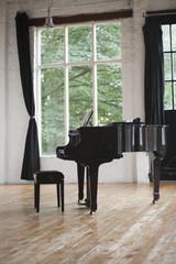 Grand Piano and Piano Stool in a rehearsal studio.