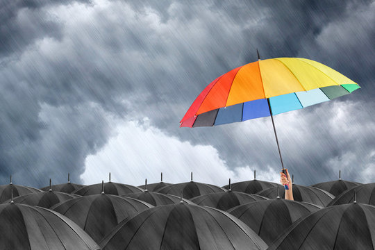 Outstanding protection concept with holding different color umbrella