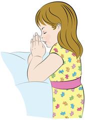 Girl praying, in her pajamas, kneeling beside her bed.