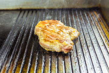 Grilled meat. Juicy steak from pork.