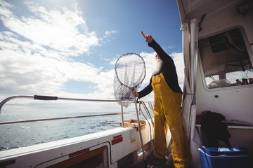 Fisherman pointing at distance