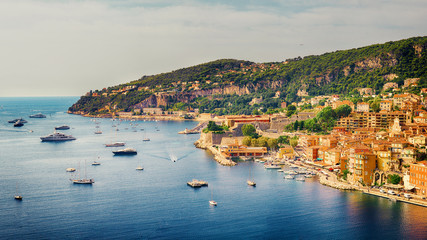 Villefranche-sur-Mer, France - 10 September, 2015: view of luxury resort and bay on sunny day. Villefranche-sur-Mer, french reviera, near Nice and Monaco