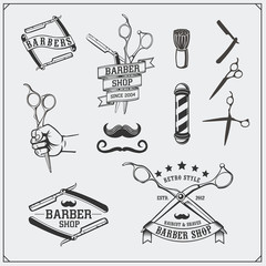 Set of vintage Barber shop design elements, labels, badges and emblems.