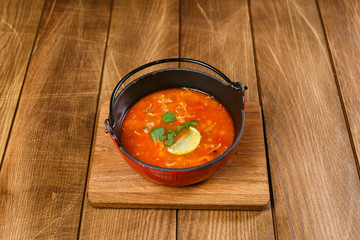Soup on wooden background
