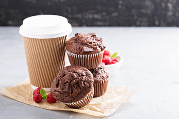 Chocolate muffins with coffee to go
