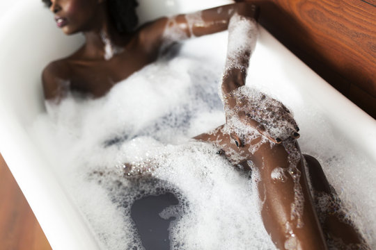 Young black woman in the bath