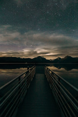 Starry sky over pier on Lake Mcdonald, Glacier National Park, Montana